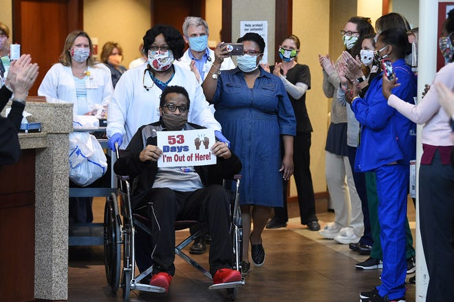 Williamson Medical Center doctors and nurses celebrate the release patient Isaiah Whalum on Tuesday, May 12, 2020, at the Franklin hospital. Whalum recovered COVID-19 and was a patient for 53 days.