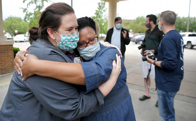 A Williamson Medical Center critical care nurse hugs India Scruggs, after Scruggs' partner Isaiah Whalum was released from the Franklin hospital on Tuesday, May 12, 2020, after recovering from COVID-19. Williamson Medical Center celebrated Whalum's release. Whalum had been a patient for 53 days.