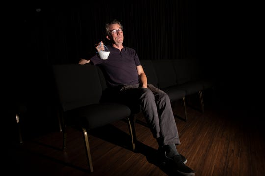 """Frank Blocker poses for a portrait, Tuesday, May 12, 2020, at the Moe Auditorium at The Center for Performing Arts in Bonita Springs. When Bocker's """"Stage It!"""" 10-minute play competition was canceled, he decided to let other playwrights send in their works for an online all-comers Social Distancing Short Play Festival."""