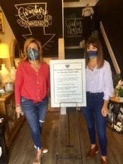 Cedar & Thread's Michele Koester and her daughter, Madison, were wearing masks on opening day May 12 and a sign at the entrance provided safety tips to shoppers.