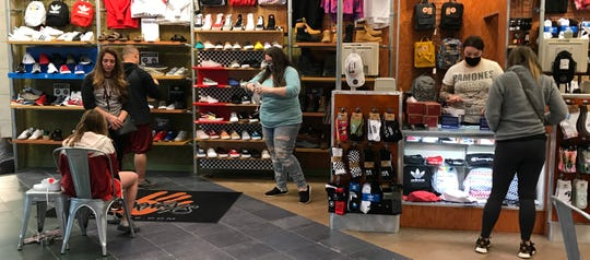 Journeys was one of about a dozen stores which reopened Tuesday at Indian Mound Mall in Heath.