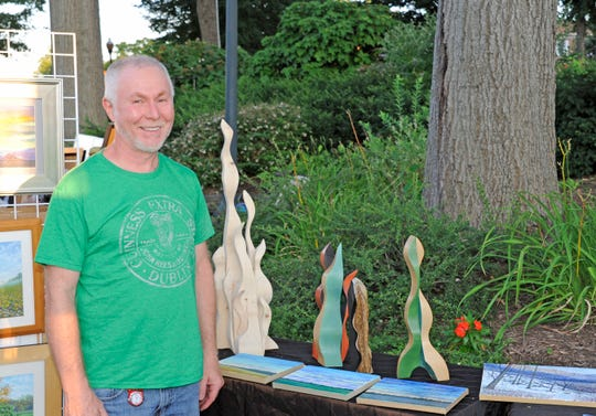 Dennis DeCarlo stands with his work at the Art in the Park in Ridgewood in 2015.