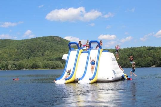 Children play on a water slide at Camp Wekeela in Maine in this file photo.