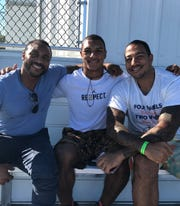 From left to right: Joe Dawkins with Aeneas DiCosmo and Anthony DiCosmo.