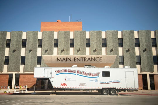 The mobile coronavirus testing unit blocks the main entrance of Rehoboth McKinley Christian Hospital in Gallup Friday, April 3.