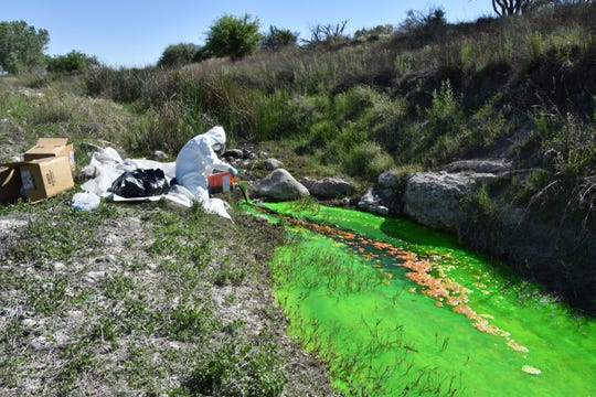 National Cave and Karst Research Institute Executive Director George Veni injects a dye into the Black River to traces its flow, May 7, 2020 in southern Eddy County.