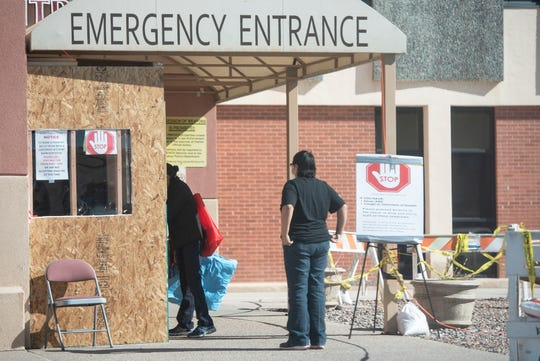 Visitors check in at the emergency entrance before entering Rehoboth McKinley Christian Hospital in Gallup Friday, April 3.