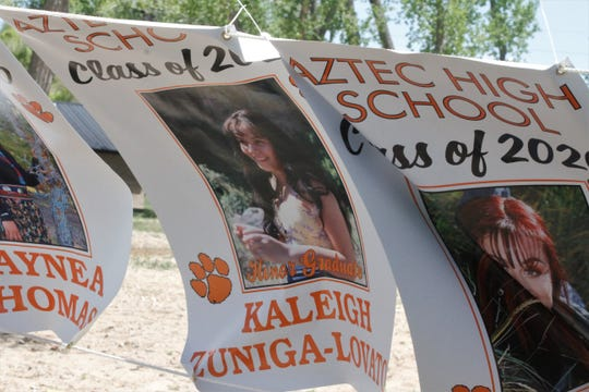 Aztec High School seniors are honored with banners featuring their pictures. These banners were hung, Tuesday, May 12, 2020, in Riverside Park.