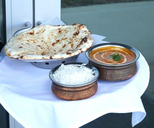 Vindu's butter chicken, naan and rice.