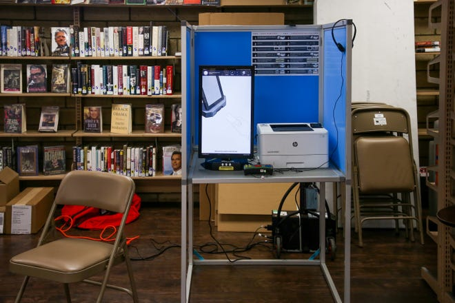 A voting booth sits available at the Desert Hot Springs Library voting location for the special election for state senate on Tuesday, May 12, 2020 in Desert Hot Springs, Calif.