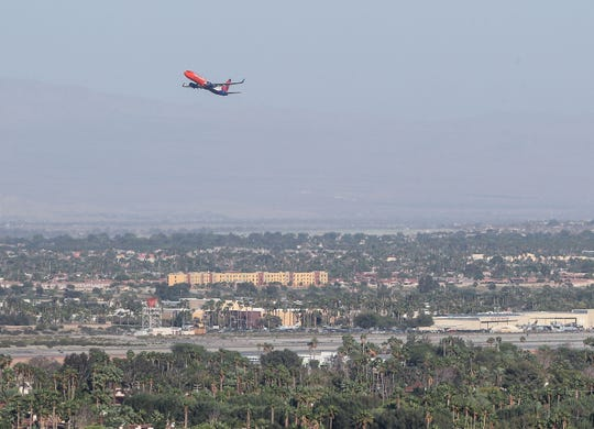 A plane departs Palm Springs International Airport as air travel to and from the Coachella Valley has dropped significantly because of the coronavirus, May 11, 2020.