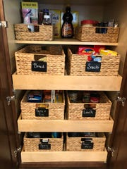"The ""after"" photo of Tracy Rutledge's pantry in her Mesa home. Creating homes for categories of items is key to organizing spaces like the kitchen pantry, said Happy Home Organizers owner Rachel Winter."