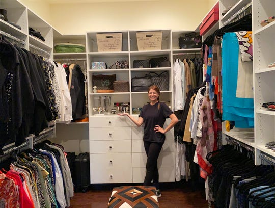 Happy Home Organizers professional Missy Feldman stands in the finished walk-in master suite closet of Alex Shepard's Paradise Valley Home.