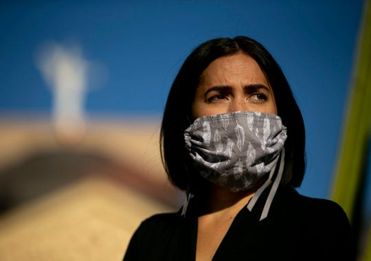 Elisa Villescaz, a high school teacher at Gilbert Public Schools, looks on during a rally to pressure the governor to not open the state up too quickly during the COVID-19 pandemic, at the Arizona state Capitol in Phoenix on May 12, 2020.