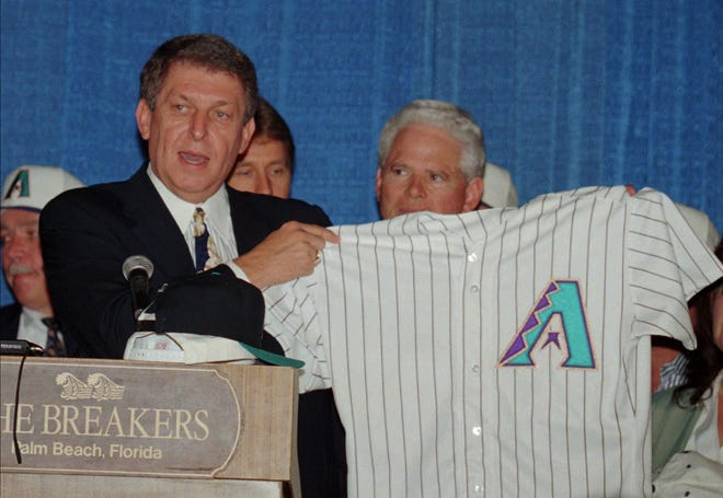 Jerry Colangelo holds up a team jersey for his newly franchised team, the Arizona Diamondbacks, Thursday, March 9, 1995, at Palm Beach, Fla.  The Diamondbacks and the Tampa Bay Devil Rays will begin play in the National Baseball League in 1998.  Neitherteam at this time has been designated to a league.  (AP Photo/Gary Rothstein)