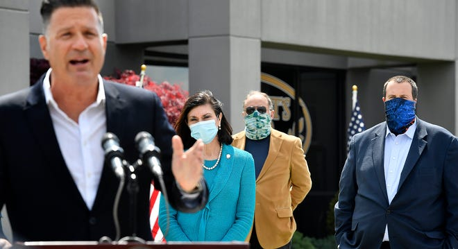 York County Senator Kristen Phillips-Hill, Rep. Keith Gillespie, and Rep. Seth Grove, listen as Senator Mike Regan addresses Governor Wolf's recent remarks a rally at Gene Latta Ford in Hanover, Tuesday, May 12, 2020. John A. Pavoncello photo