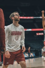 University of Arkansas men's basketball graduate assistant coach Sean Bair waits to rebound a shot during practice. Bair was previously the New Oxford High boys' basketball coach before he took the position.
