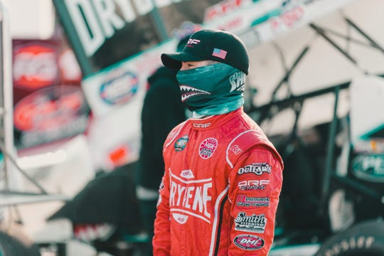 World of Outlaws driver Logan Schuchart wore a Shark Racing team face shield on Friday to comply with regulations during the event. The Hanover native finished third in the Iowa race that was held without fans.