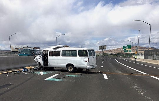 A photo of a white van that crashed into another vehicle, sending it flying off the freeway and down 50 feet onto a lot on East Fourth Street on Tuesday, May 12, 2020. The crash seriously injured two drivers.