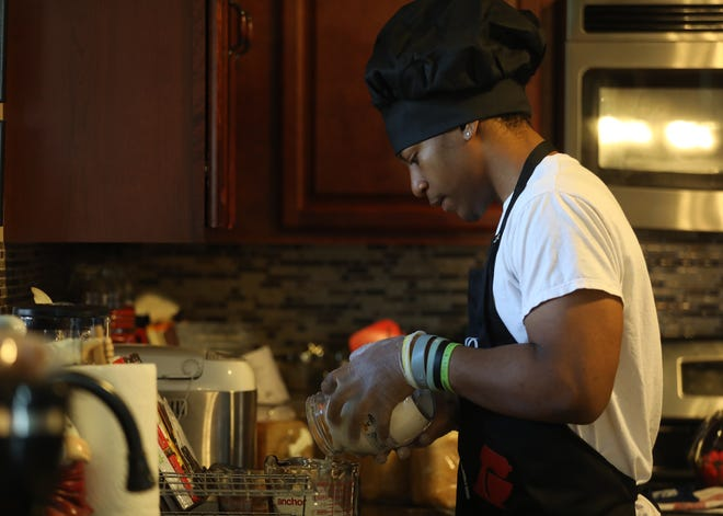 Azariah Evans, known as Ace, makes eight loaves of bread two days a week and sells it with help from his mother, Ta'Meca Dunning of Wheatland,  who takes the online orders and makes the order cards.  Evans, who has a loaf of almond milk with honey going in the bread maker on Tuesday, May 12, 2020, prepares another batch.
