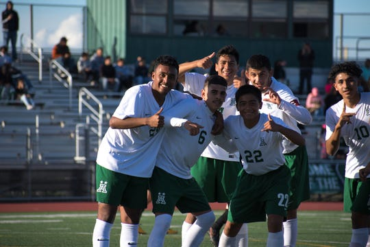 The Trojans celebrate one of Amezcua's multiple goals against Bella Vista in the CIF NorCal Division II semifinals.