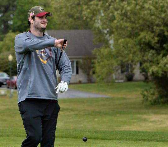 Jimmy Monaghan eyes the green at Nutters Crossing Golf Course on Tuesday, May 12, 2020.