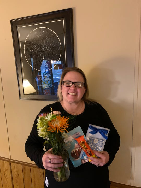 """Aubrey Byrnes, 32, poses for a photo with a surprise Mother's Day gift from her """"adopted senior,"""" Noah Lloyd. The two families connected through the Sioux Falls area """"Adopt A Senior"""" Facebook group."""
