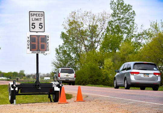 A speedometer from the sheriff's department is attached under a speed limit sign on County Highway 110 on Tuesday, May 12, in Harrisburg.