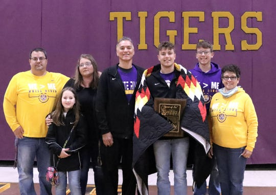 Head Coach Eldon Marshall (fourth from left), Nick Sayler, White River HS Principal Peri Strain (right), and the Sayler Family