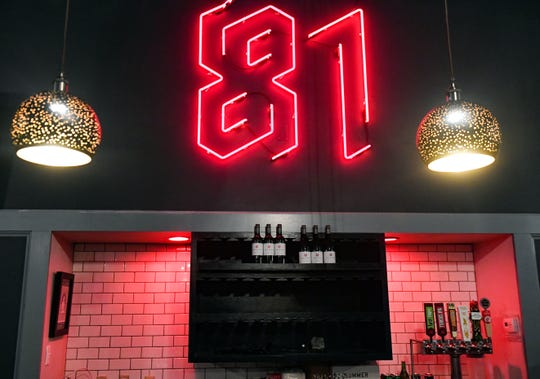 A neon sign hangs above the bar at the new 81 Arcade Bar location on Monday, May 11, on Phillips Ave. in Sioux Falls.