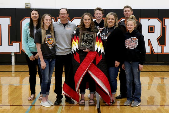 Faith senior Sydnie Schauer, center, was named winner of the Spirit of Su Award on Tuesday, May 12, 2020 following the conclusion of the 2019-20 Class B girls basketball season.