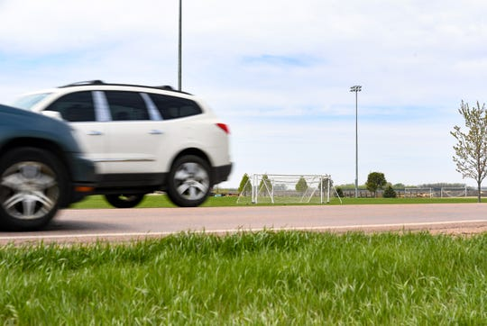 Cars drive past the Dakota Alliance practice fields on Tuesday, May 12, on County Highway 110 in Harrisburg.