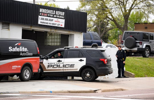 Police report to Safelite Auto Glass after reports of shots fired on Tuesday, May 12, on Minnesota Ave. in Sioux Falls.