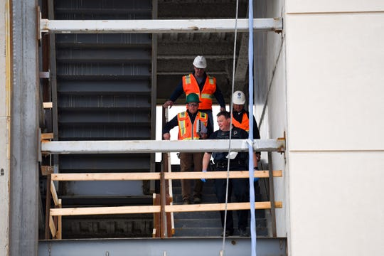 Police and the Occupational Safety and Health Administration investigate where a worker fell off the construction site of a new bank building on Tuesday, May 12, on Minnesota Ave. in Sioux Falls.