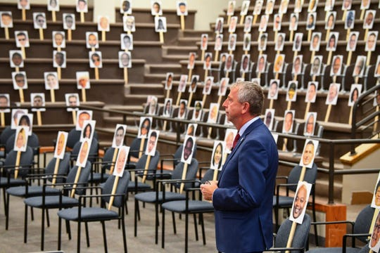 St. Cloud Mayor Dave Kleis prepares to give his State of the City presentation surrounded by printed photos of community members in the audience Tuesday, May 3, 2020, at St. Cloud City Hall.