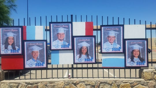 Anthony High School has decorated the fence of the high school with framed posters of its graduates.
