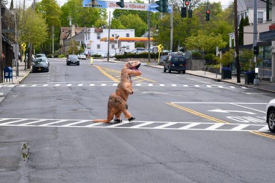 T. rex crossing a street in Pleasantville
