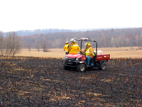 Fires can also burn on harvested crop fields. This fire, from a brush pile burn, was quickly extinguished by local firefighters after it had burned over a few acres of the cornfield.