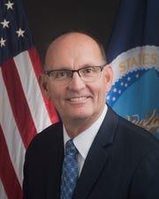 Greg Ibach, Under Secretary for Marketing & Regulatory Programs portrait and passport in Washington, DC on Nov. 14, 2017.