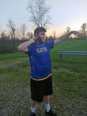 Philo's Logan Wickham gets ready to practice throwing the shot put. Wickham may have lost his senior season but will continue his throwing career with Muskingum University.
