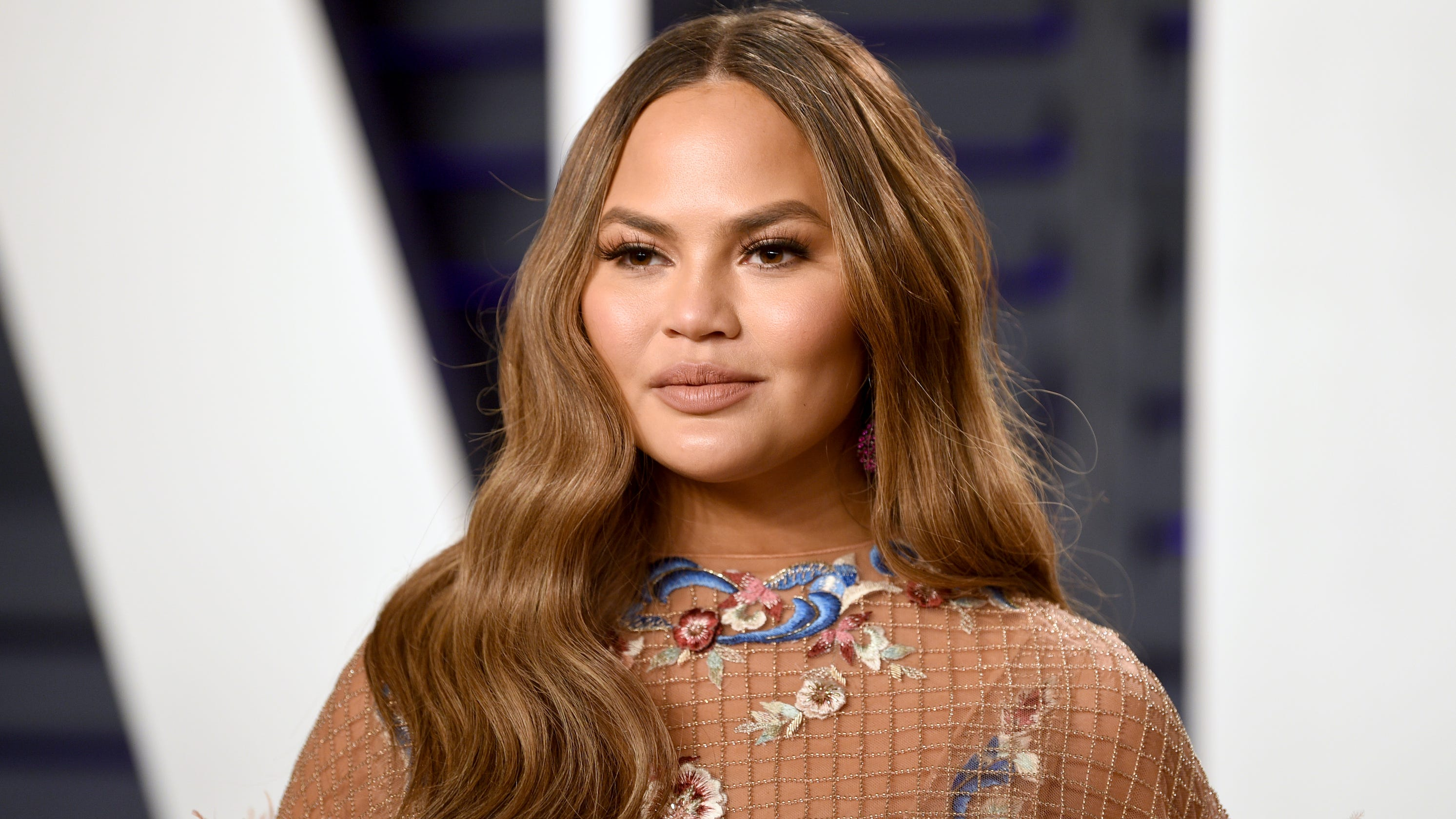 Chrissy Teigen says she's on 'serious bed rest' during her 'difficult' third pregnancy thumbnail