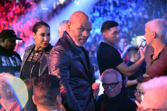 Could Mike Tyson, shown attending the fight between Deontay Wilder and Tyson Fury in February, step back into the ring?