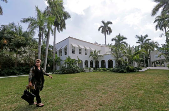 Deirdre Marie Capone, grandniece of Al Capone, walks in the backyard of the waterfront mansion once owned by Al Capone.