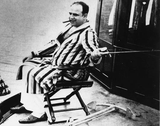 The real Al Capone, seen fishing off Palm Island, Florida.