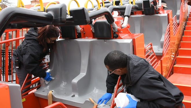 When Six Flags reopens its parks, employees will be wiping down frequently touched surfaces such as rides more often.