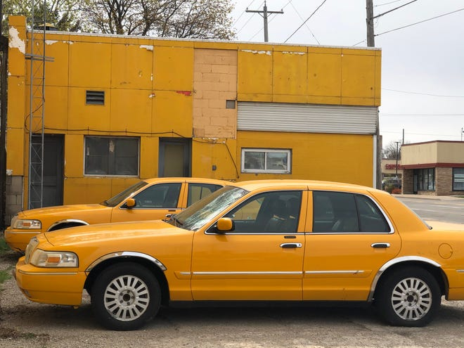 The last two yellow cabs are parked outside Appleton Yellow Taxi's closed building in Appleton.