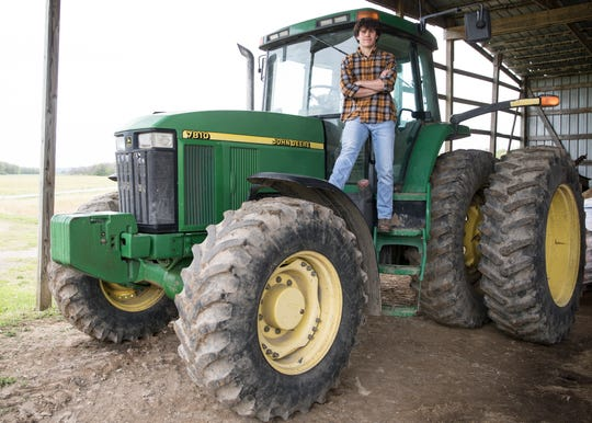 While working at the family farm, one of Ben Corcoran's passions is driving and working with tractors.