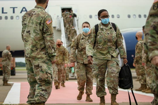 Soldiers from the 586th Field Hospital redeploy to Fort Campbell on May 12, 2020, after being deployed for more than a month to New York City to assist in the fight against COVID-19. They immediately had to go into a mandatory 14-day quarantine.