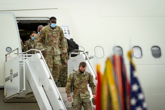 Soldiers from the 586th Field Hospital redeploy to Fort Campbell on Tuesday, May 12, 2020, after being deployed for more than a month to New York City to assist in the fight against COVID-19. They immediately had to go into a mandatory 14-day quarantine.
