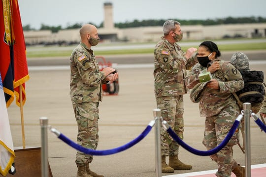 Maj. Gen. Brian Winski and CSM Bryan Barker applaud as soldiers from the 586th Field Hospital redeploy to Fort Campbell on Tuesday, May 12, 2020, after being deployed for more than a month to New York City to assist in the fight against COVID-19. The soldiers immediately had to go into a mandatory 14-day quarantine.